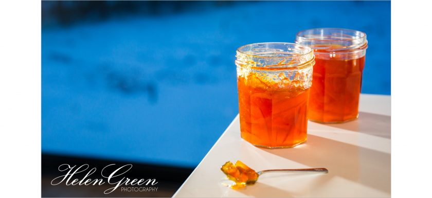 2 jars of homemade marmalade with snow in background helen green photography