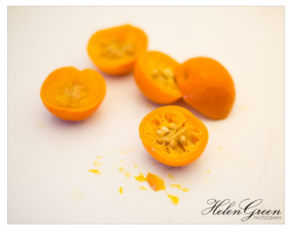 seville oranges boiled and cut in half helengreenphotography