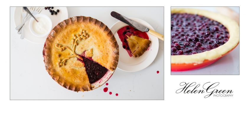Blackcurrant pie with a slice cut out and before the pastry lid has been placed on top