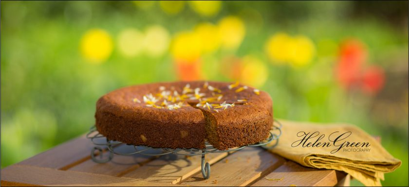 Dandelion and honey cake with yellow tulips in background